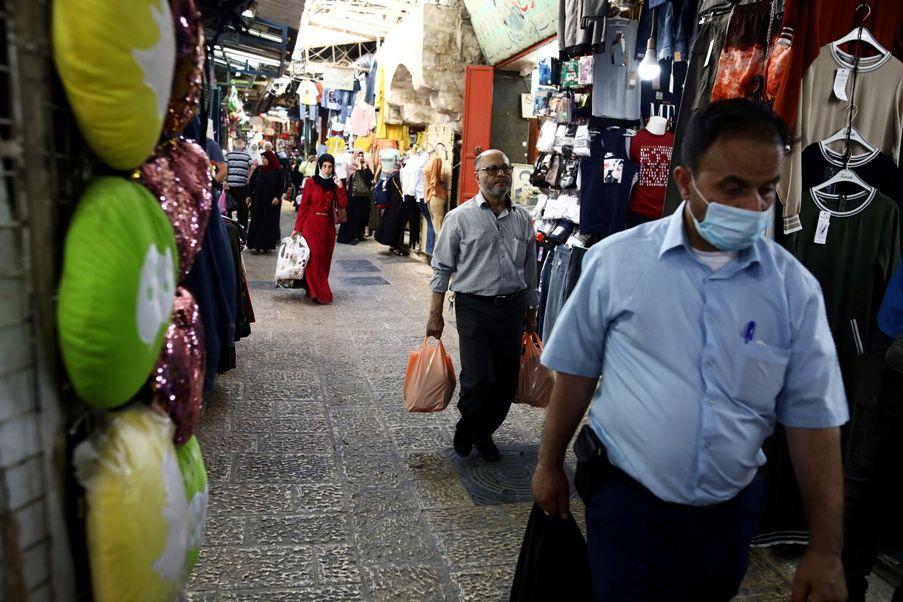 سوق في فلسطين - كورونا في فلسطين